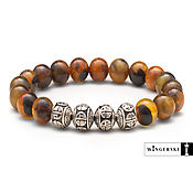 Украшения handmade. Livemaster - original item Bracelet made of Baltic amber with silver charms. Handmade.