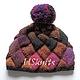 Вязаная шапка `Квадраты с большим помпоном`