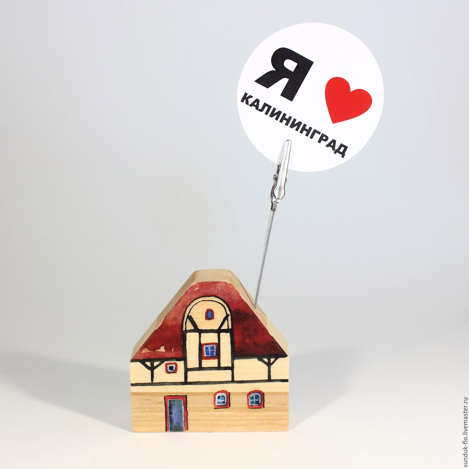 Wooden house with a pin