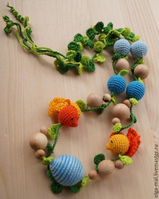 Слингобусы - оригинальный и полезный подарок для мамы и малыша.В слингобусах чередуются обвязанные и не обвязанные бусины.