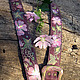 Dull - purple background of the belt. pinkish flowers, sprigs of different shades of green, to garments of many colours fit this belt, and jeans will be good.