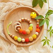 Одежда handmade. Livemaster - original item Kit holder for pacifiers and teething toy-rattle sun. Handmade.