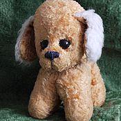 Винтажная собака с большими глазами.