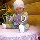 Детский комбинезон и лейка тоже продаются в магазине.