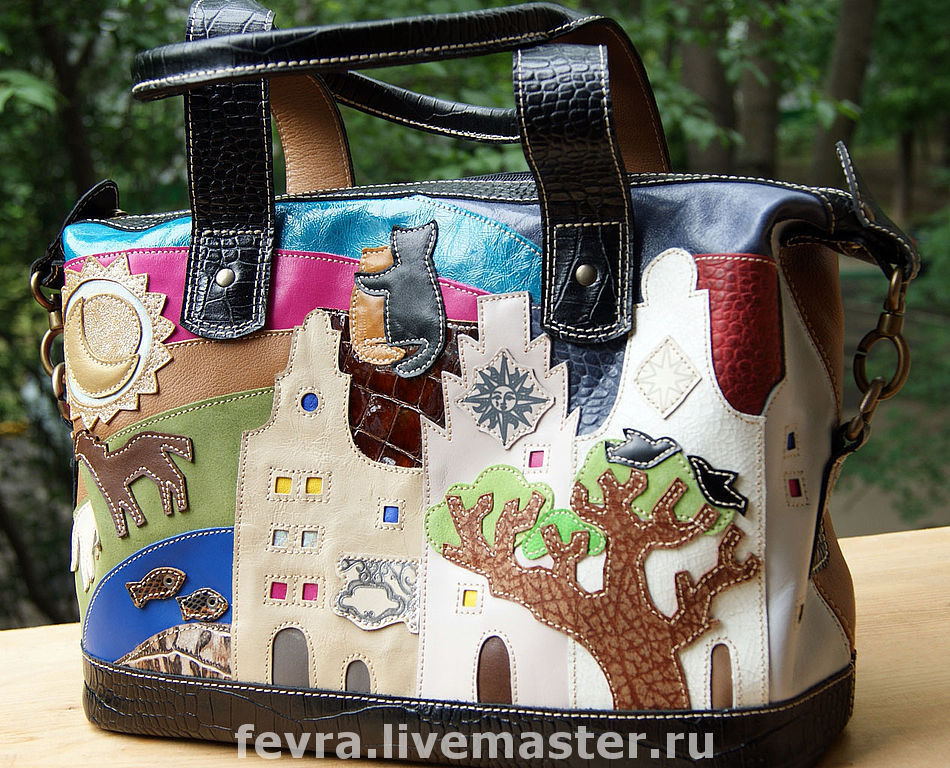 Bag with black trim, the bag itself is a bright, back - relaxed reddish color (like the inside handles).