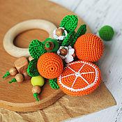 Прорезыватель-кольцо с апельсинками