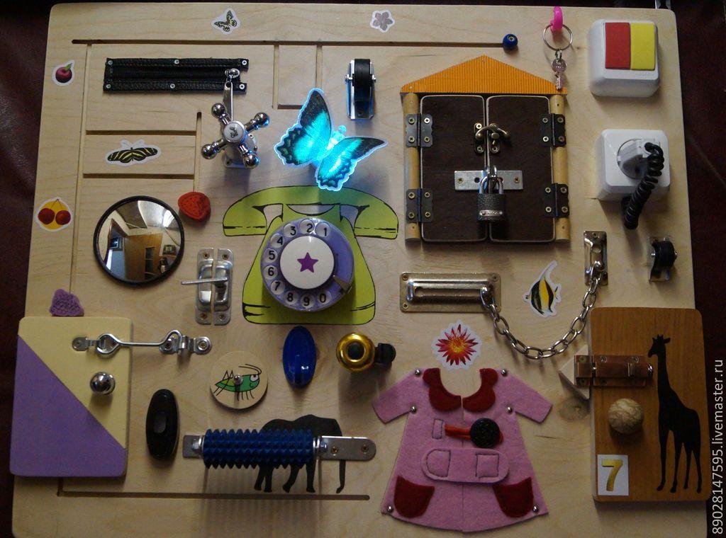 Развивающая доска для ребенка с выключателями из фанеры