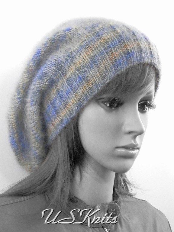 Вязаная женская шапка (шапочка) `бини` выполнена из мохера класса `люкс`. В состав пряжи входит кид мохер и натуральный японский шелк. Связана шапка в две нити, что делает ее очень теплой.