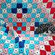 Большое, цветное, ажурное мягкое покрывало, связанное крючком из хлопчатобумажных ниток. Рисунок в виде цветов. Обрамлено тонкими кистями. Можно накинуть на кресло, диван или кровать. Украсит интерьер