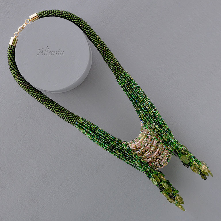 Necklace with beaded strap and beaded strands color forest green. A massive green beaded necklace. green and pink. Original beaded jewelry from Altania.