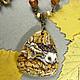 `Ёжик и гриб`  Пейзажная яшма, размер 40 х 44 мм. Шнур - античная бронза + деревянные бусины.