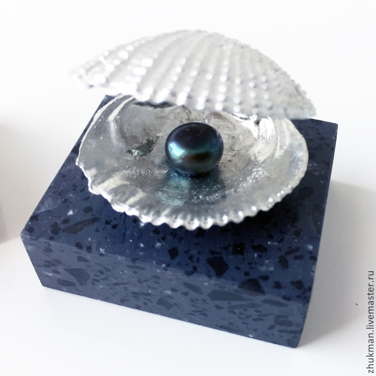 A Miniature Shell With A Black Pearl Gift For Pearl Wedding