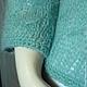 Невероятно уютный и воздушный вязаный спицами мятный кардиган из мохера с застежкой под грудью и рукавами 3/4 придаст Вашему образу легкости и женственности.