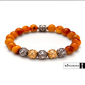 Украшения handmade. Livemaster - original item Bracelet Vintage rings of Baltic amber with silver charms. Handmade.