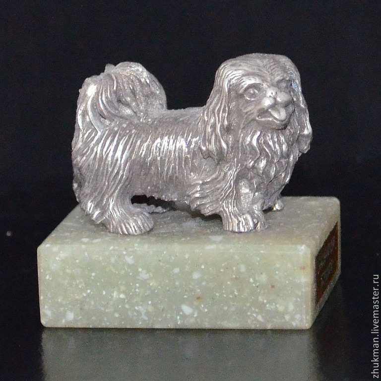 The miniature figure `Pekinese`. There are figurines of dogs of other breeds: Bichon Frise, Airedale Terrier, poodle, Spaniel, Dachshund. There are figurines of other animals: bear, elephant, turtle,