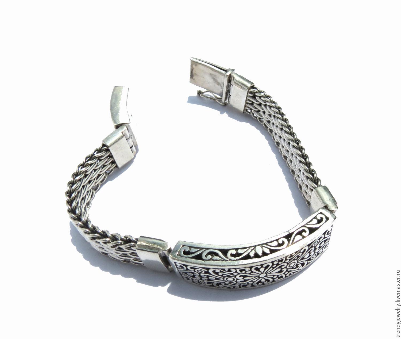 Мужской браслет с красивыми узорами из серебра