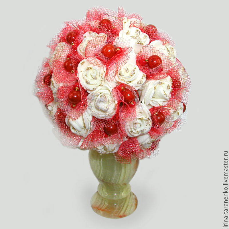 The coral flowers of `Wedding` in a vase of onyx