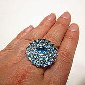 Кольцо серебряное с голубыми топазами.