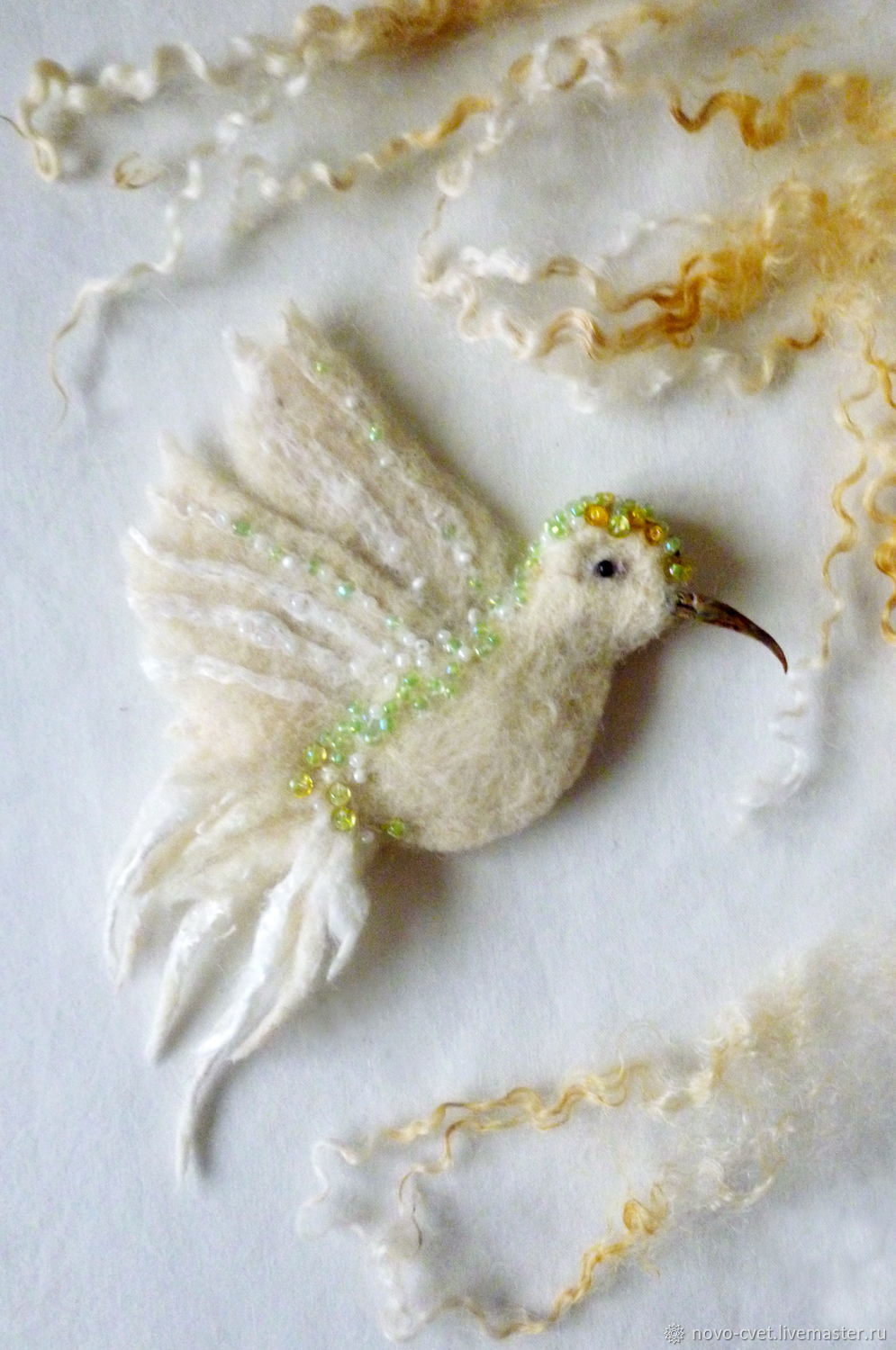 Decorate a scarf or your purse.Felted brooch ` Bird `made of wool ,decorated with beads,fibers, viscose,metallic sequins.