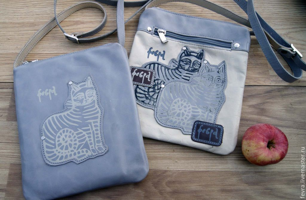 Now there are two cover pouches with cats.