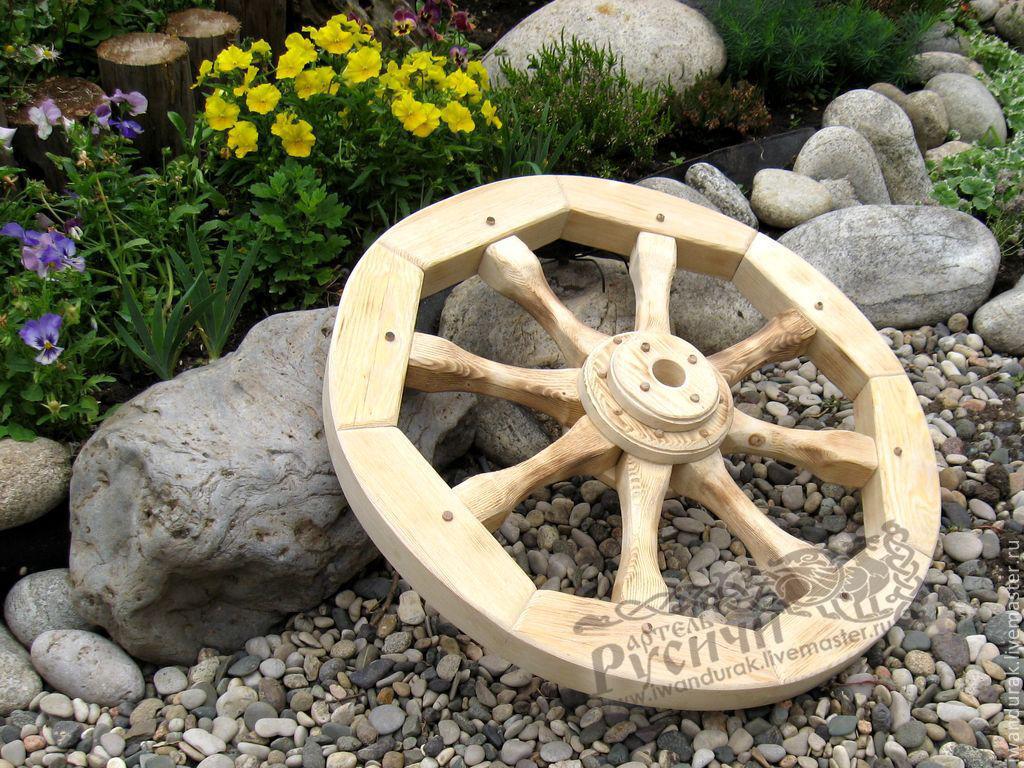 Фото поделки из колес от телеги