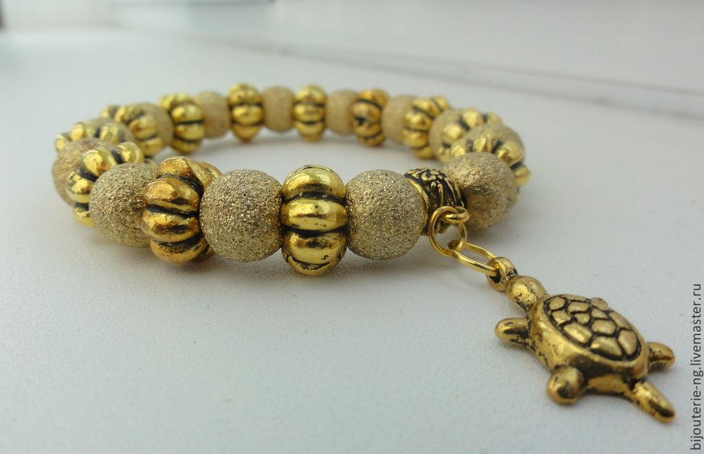 Браслет золото бусины