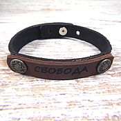 Украшения handmade. Livemaster - original item Thin leather bracelet with embossed and engraved Freedom. Handmade.