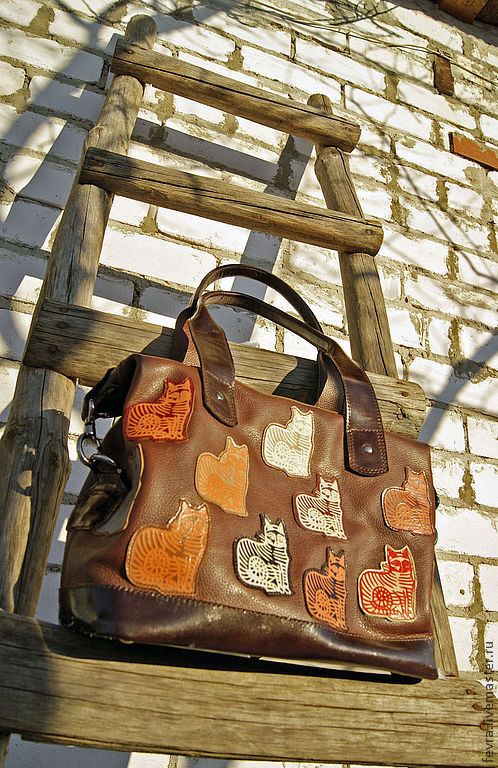 Spring! and cats tend to walk! even those that are sewn onto the bag....