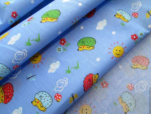 Ситец`Ежик на голубом` ра-р ёжика-3 см. ра-р солнышка-2 см