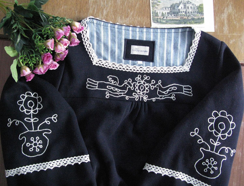 Фрагмент вышивки платья.