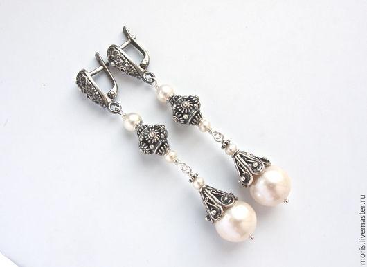 Серебряные серьги с натуральным белым жемчугом. Красивые  серьги из серебра и натурального белого жемчуга, трех размеров. Крупные, круглые жемчужины 11мм,  с небольшими вмятинами от песчинок.