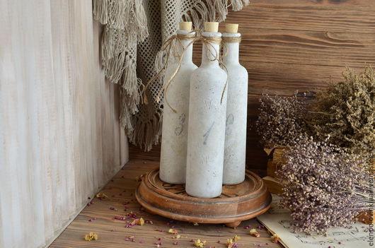 Набор бутылочек на подставке для хранения масла и настоев пряных трав.