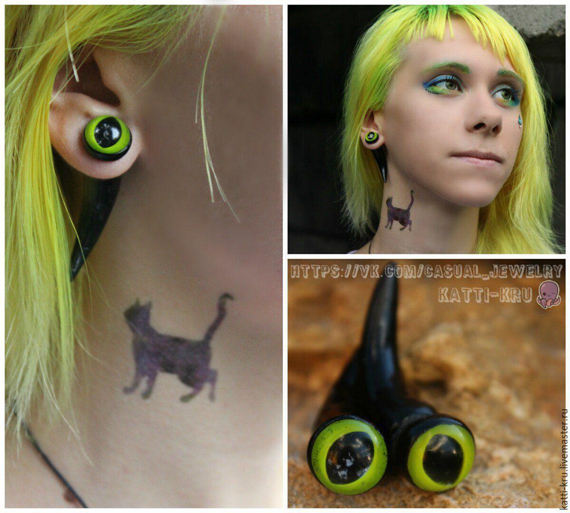 Earrings faux fangs (luristanica) `Cat`s eye`