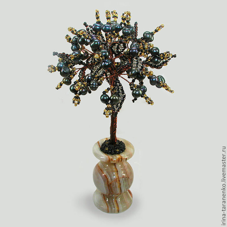 The tree of life of black pearls in a vase of onyx