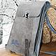 Серый планшет был сделан на заказ для мореплавателя.
