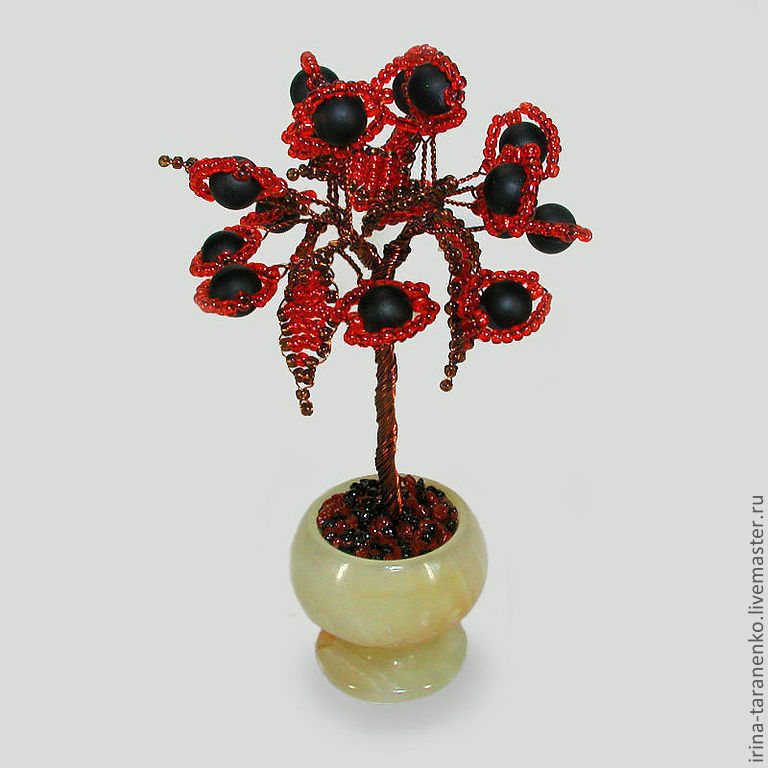 The miniature tree of love shungite in a vase of onyx